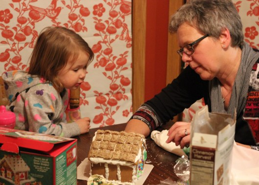 Lily and Annie working on the Gingerbread House
