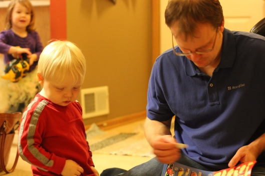 "Carson (left) and David (right) focusing on their own ""Cars"" sticker book"